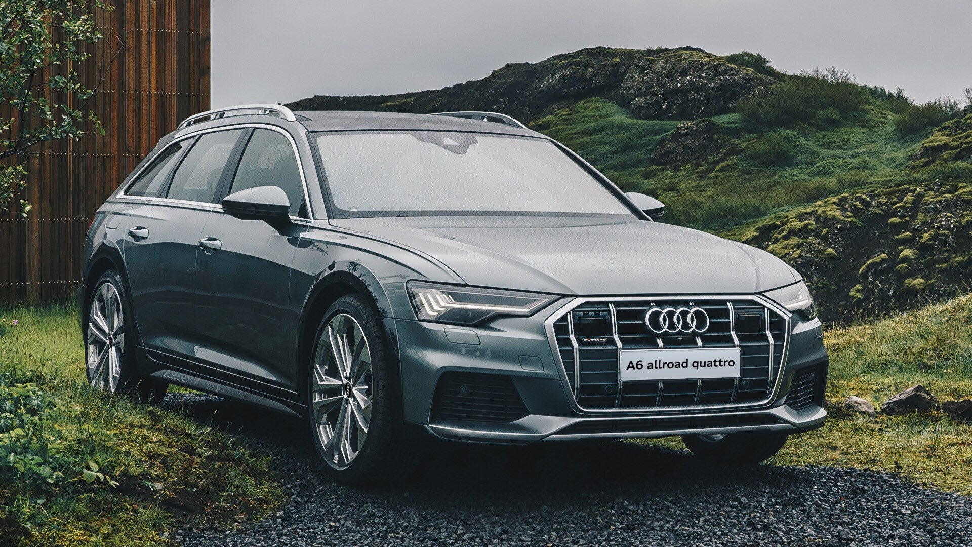 Audi A6 allroad quattro 2019 (вид сбоку и спереди)